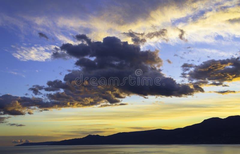 Solnedgång över Kvarneren, Rijeka, Kroatien royaltyfri bild