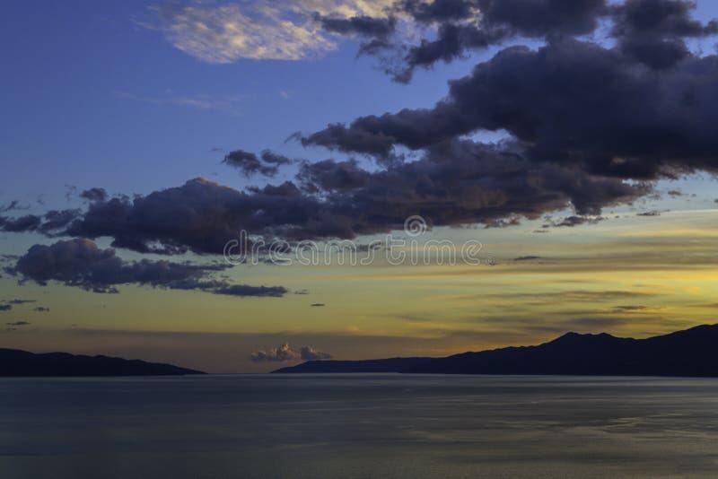 Solnedgång över Kvarneren, Rijeka, Kroatien royaltyfria foton