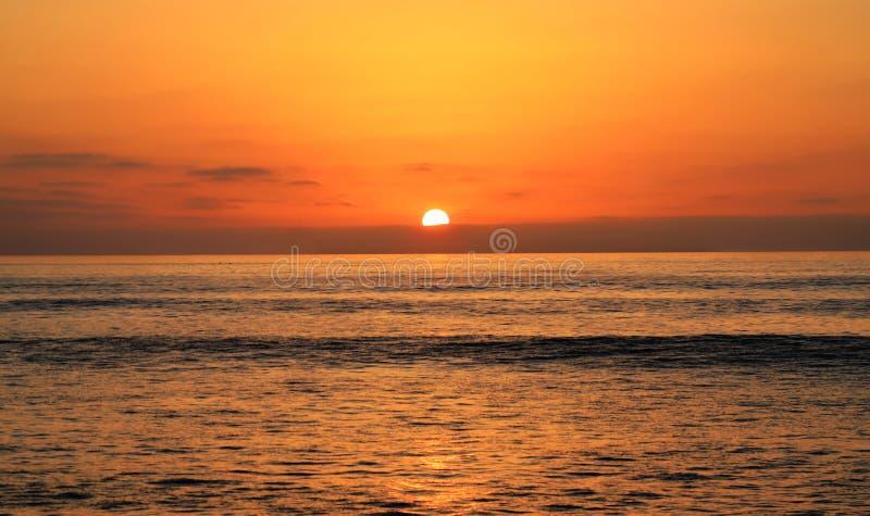 Solnedgång över Stilla havet arkivfoto
