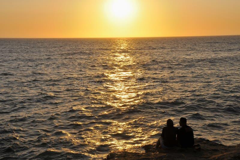 Solnedgång över Stilla havet arkivbilder