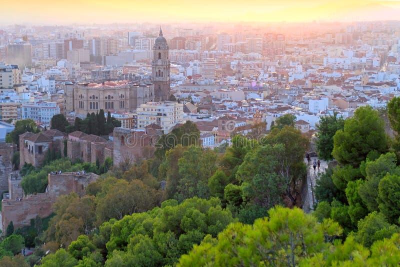 Solnedgång av den Malaga staden, Spanien arkivfoto