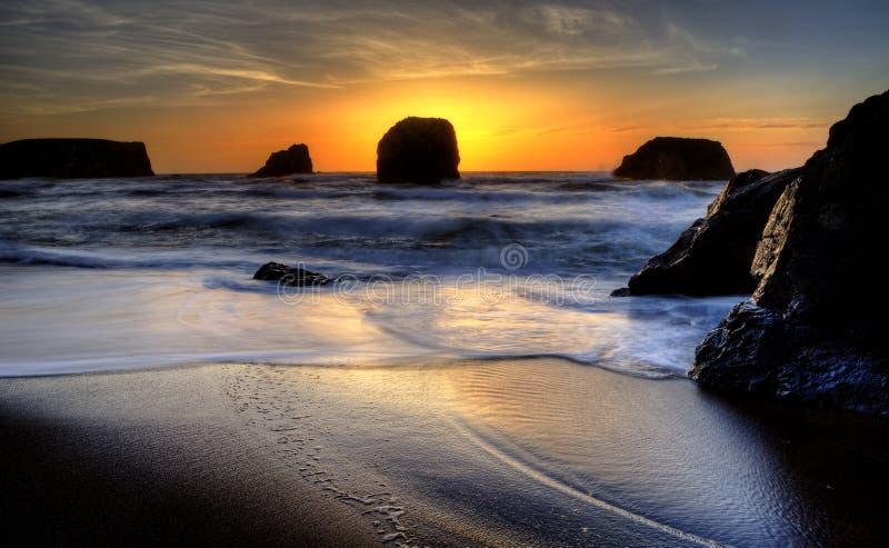 Solnedgång Bandon Oregon royaltyfria foton