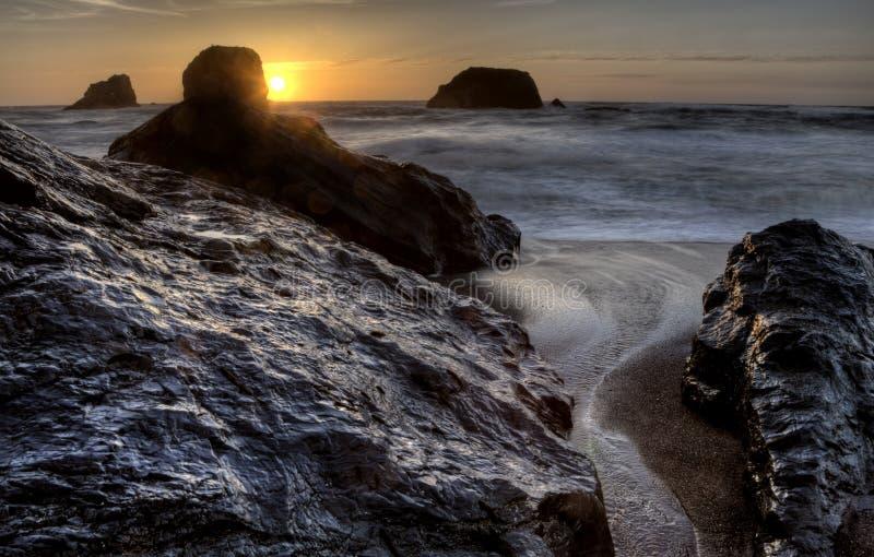 Solnedgång Bandon Oregon royaltyfri bild