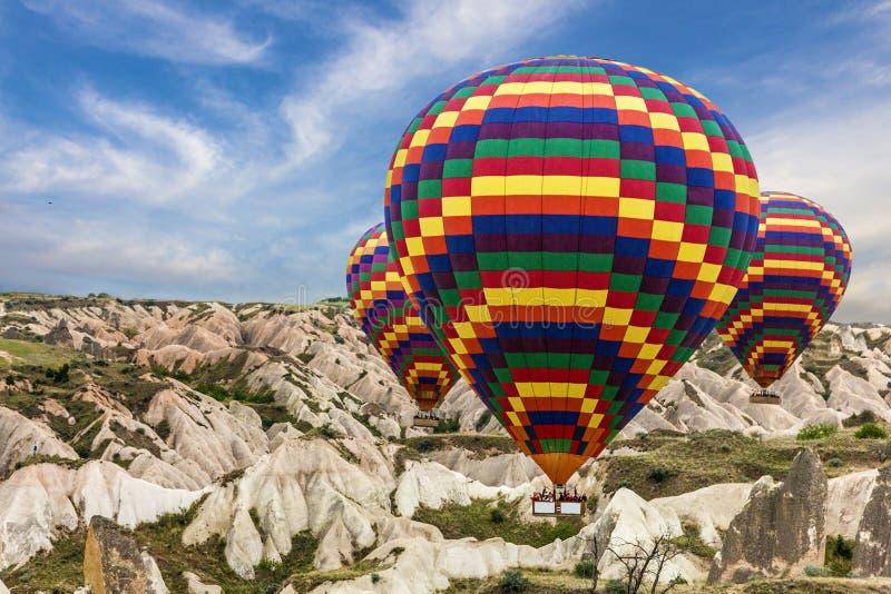 Solnedgång för ballonger för varm luft, Cappadocia, Turkiet arkivfoto