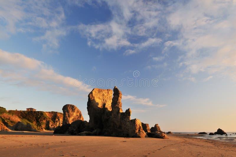 solnedgång för bandonbildandeoregon rock royaltyfri foto