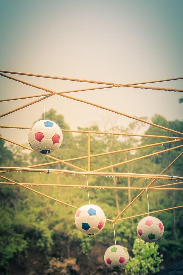 Solnedgång för fotbollsolnedgångfotboll royaltyfri fotografi