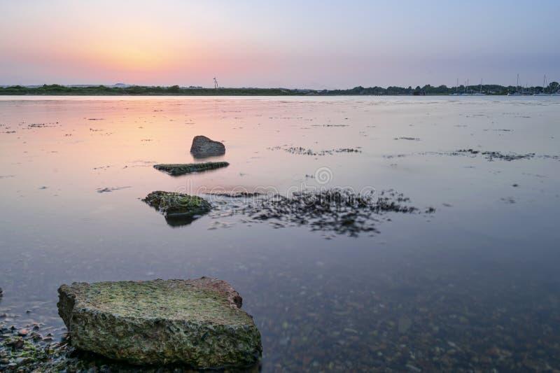Solnedgång för Hayling ö, Hampshire royaltyfri foto