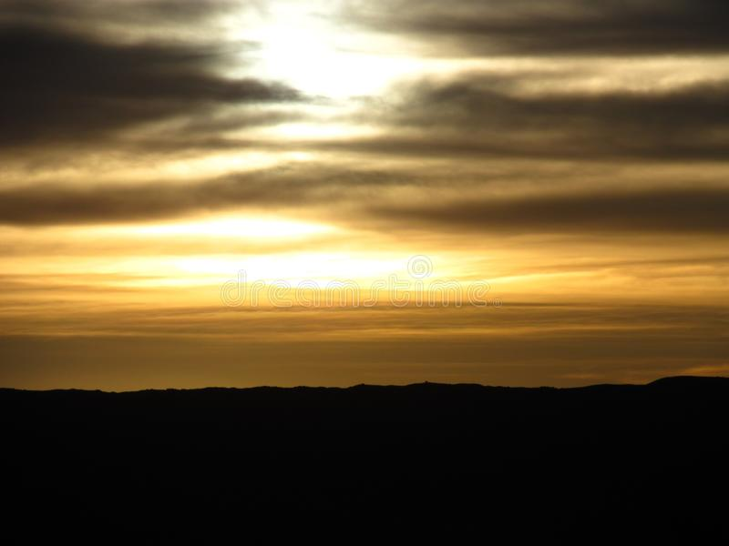 Solnedgång i Amantany 2012 arkivbild
