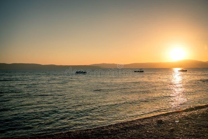 Solnedgång i Krk, Kroatien royaltyfria foton