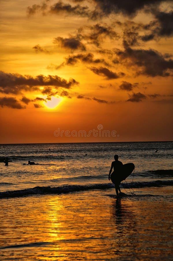 Solnedgång i Kuta strand 001 arkivbilder