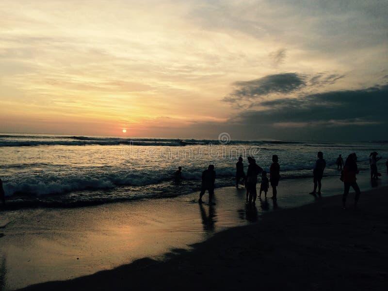 Solnedgång i kutaen Bali arkivfoto