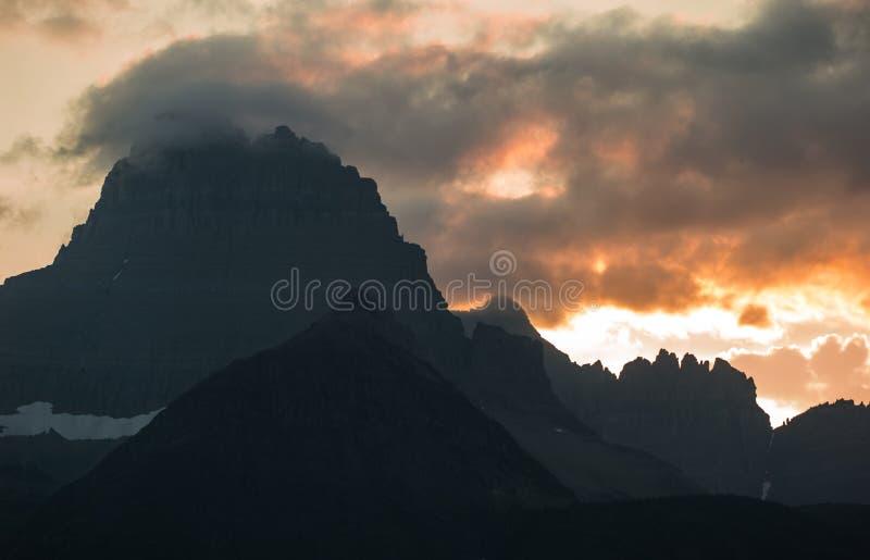 Solnedgång i många glaciär Montana arkivbilder