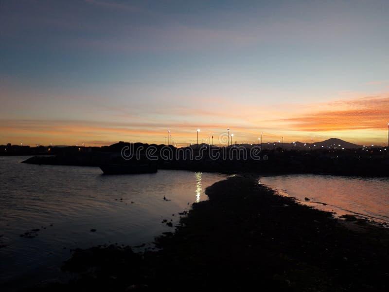 Solnedgång i Marocko sjön Marschika royaltyfri foto