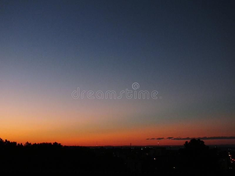 Solnedgång i Porto Alegre, Brasilien arkivbilder
