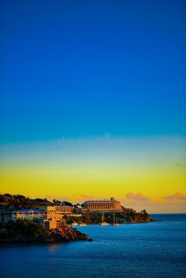 Solnedgång i St Thomas arkivbild