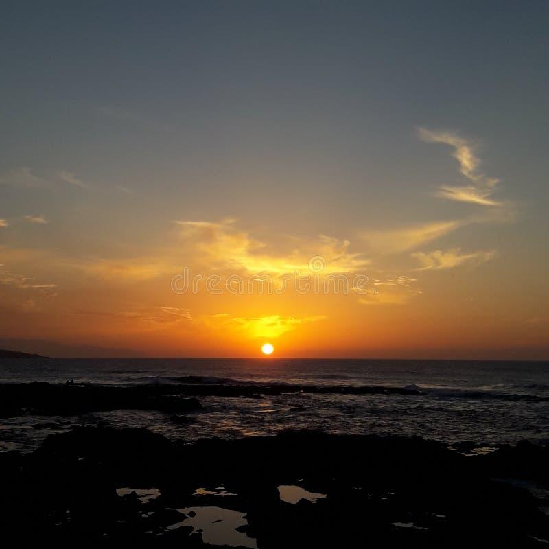 Solnedgång i stranden royaltyfria bilder