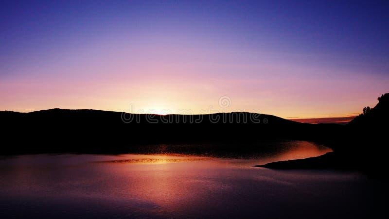Solnedgång Lake arkivfoton