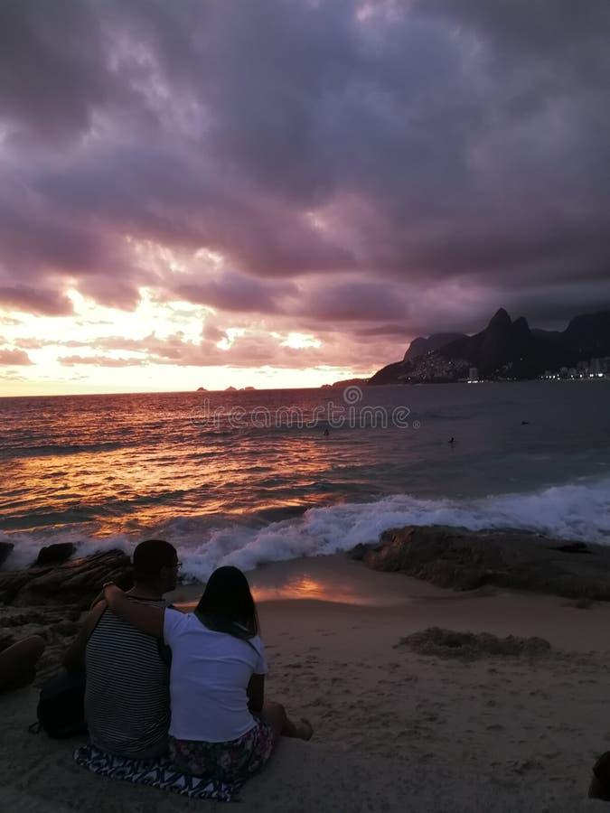 Solnedgång och ett par royaltyfria bilder