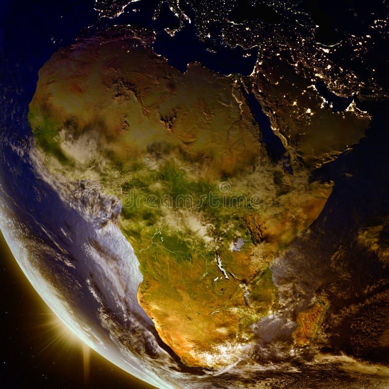 Solnedgång ovanför Afrika från utrymme royaltyfri illustrationer