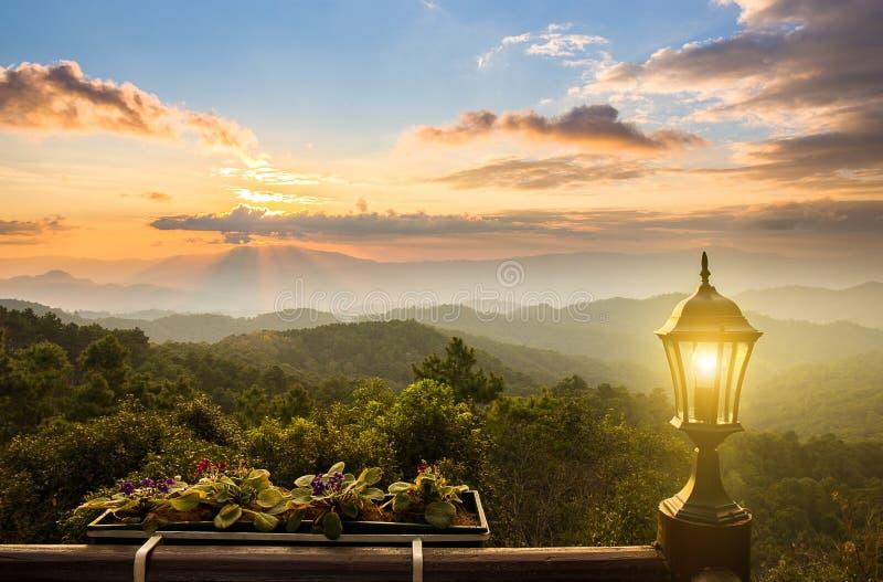 Solnedgång på berget från balkongsikt royaltyfria foton