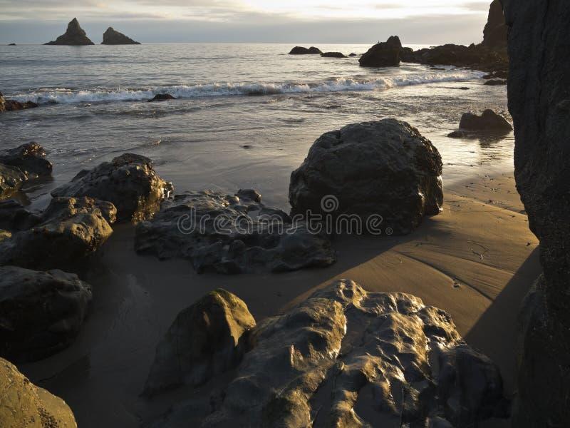 Solnedgång på den Harris stranden arkivfoto
