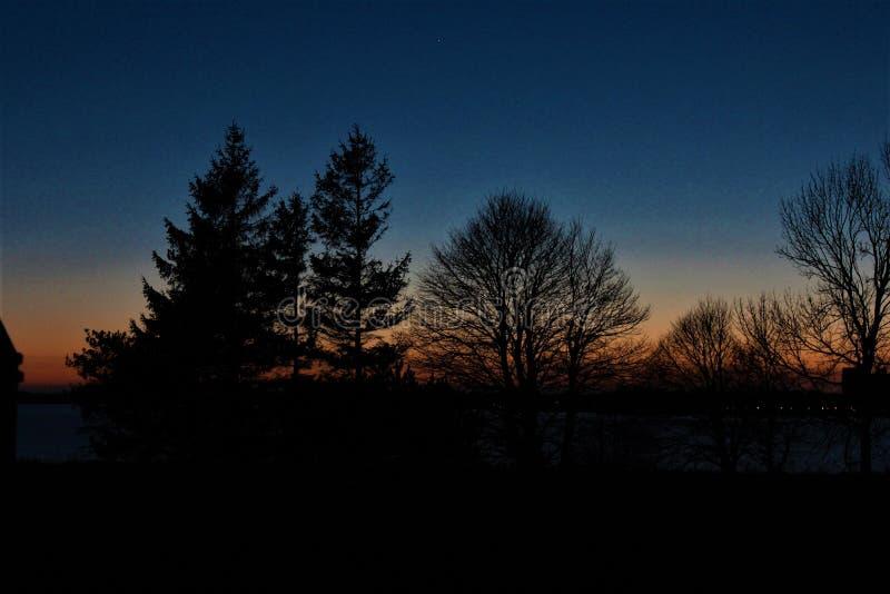 Solnedgång på fläcken arkivfoto