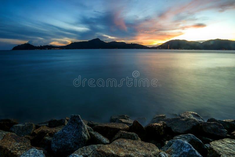 Solnedgång på Lumut, Malaysia royaltyfri foto