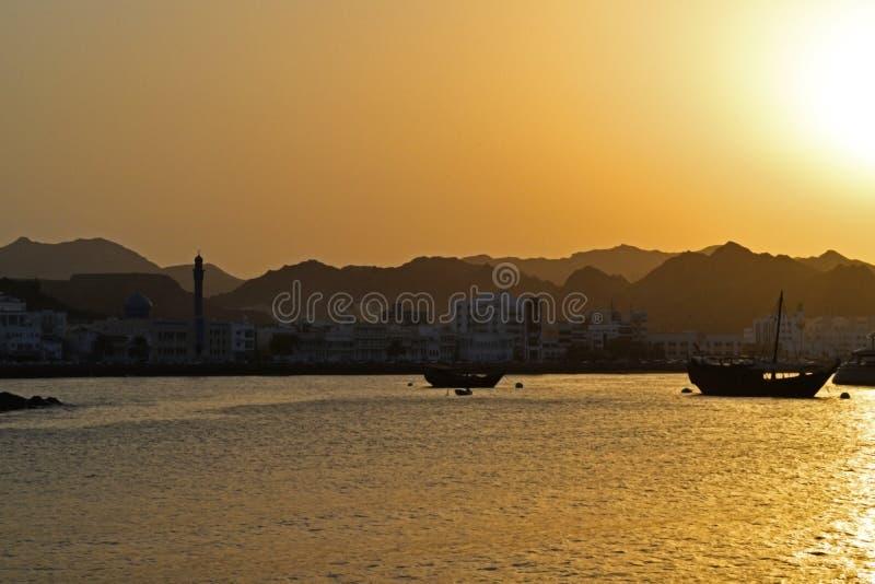 Solnedgång på Muscat royaltyfria foton
