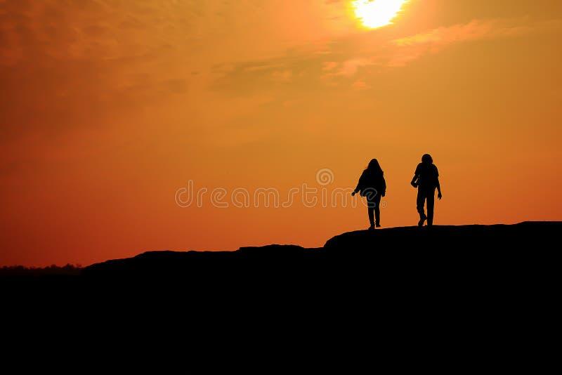Solnedgång på rocken royaltyfria foton