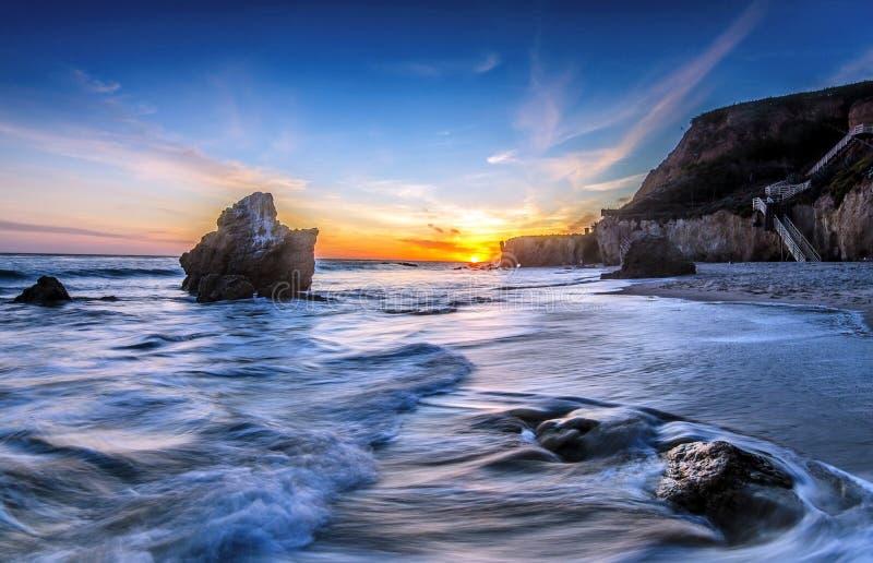 Solnedgång på stranden för El Matador royaltyfria bilder