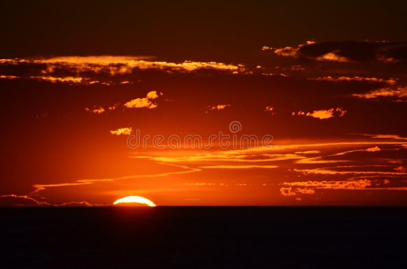Solnedgång på udde Palliser royaltyfria foton