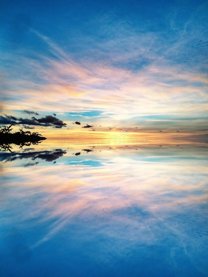 Solnedgång- & soluppgånghav arkivbild