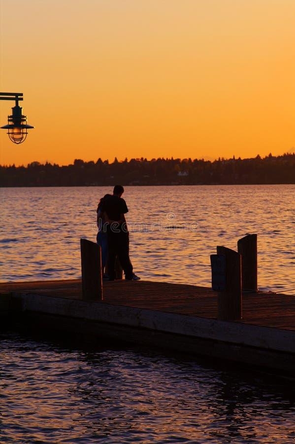 solnedgång tillsammans royaltyfri bild