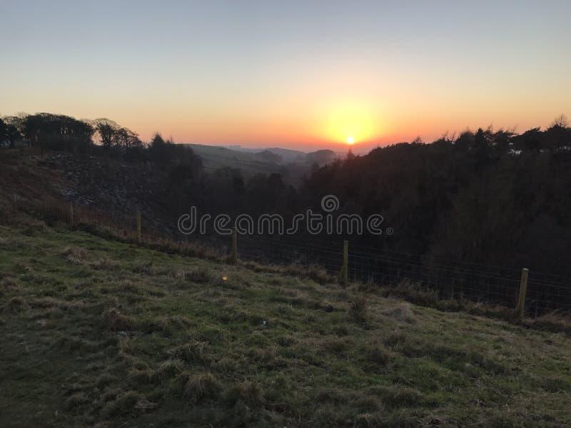 Solnedgången i Lyme parkerar arkivfoto