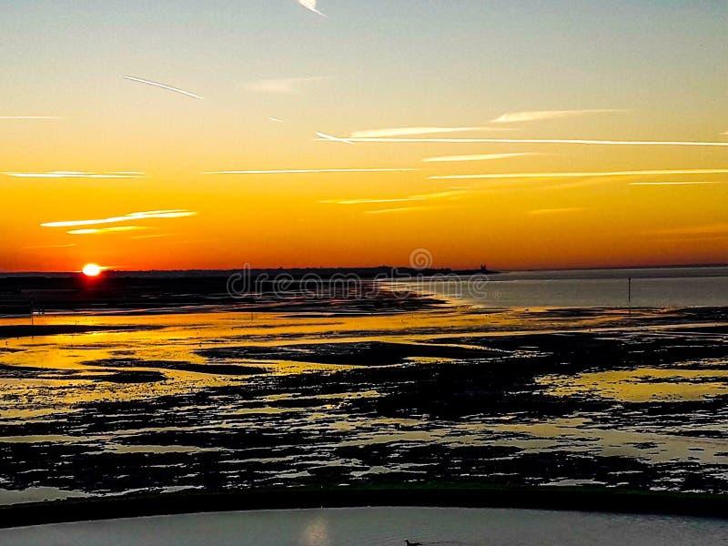 Solnedgången på den Minnis fjärden arkivbild