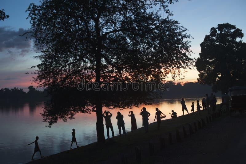 Solnedgångfotografer arkivfoto