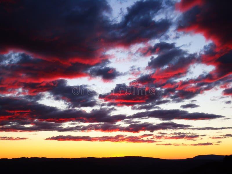 Solnedgånghimmel i Sydney fotografering för bildbyråer