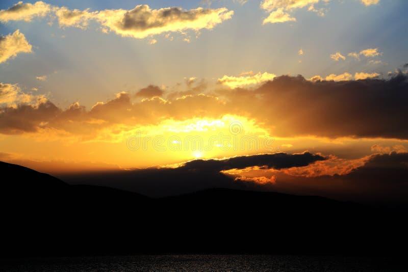 Solnedgånglandskapet av Erhai sjön royaltyfria foton