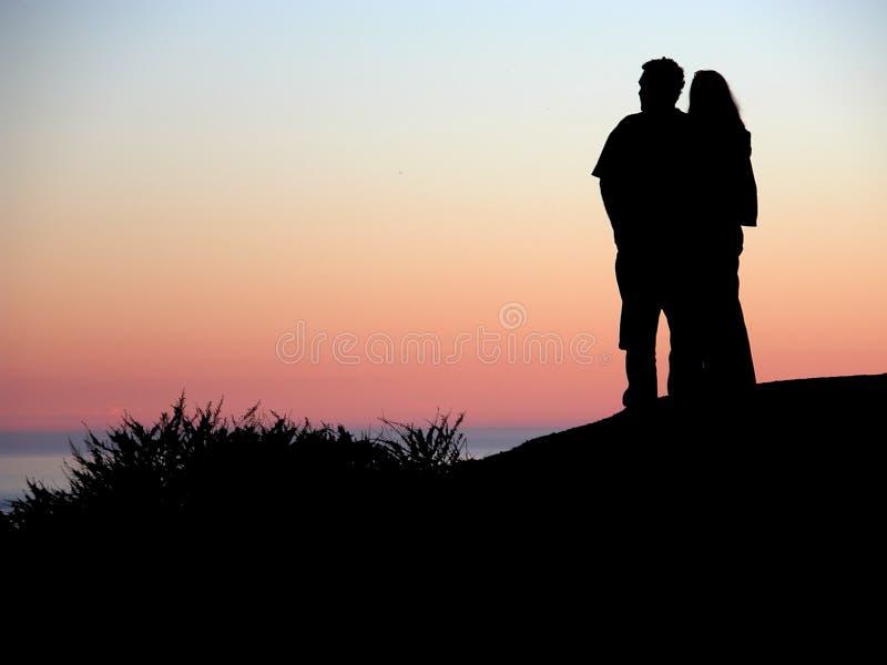 solnedgångtogetherness royaltyfri fotografi