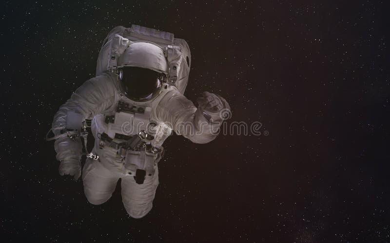 Solo astronauta en espacio exterior Los elementos de esta imagen fueron suministrados por la NASA imagenes de archivo
