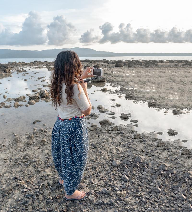 Solo Girl Traveller, a trendsetter in her 20s, wearing Ethnic Indian Dress with Polka dots is travelling solo and exploring nature stock image