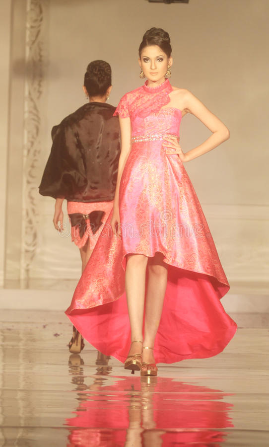 Indonesian Female Model at Fashion Show Wearing Lattest Collection royalty free stock photos