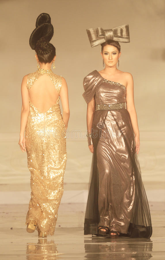 Indonesian Female Model at Fashion Show Wearing Lattest Collection stock photos