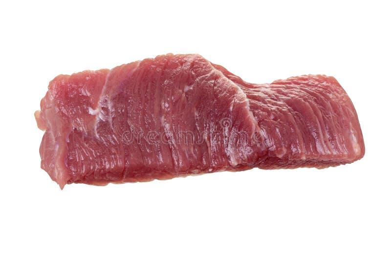 Solo pedazo de la carne cruda de cerdo o de carne de vaca aislada en el fondo blanco foto de archivo