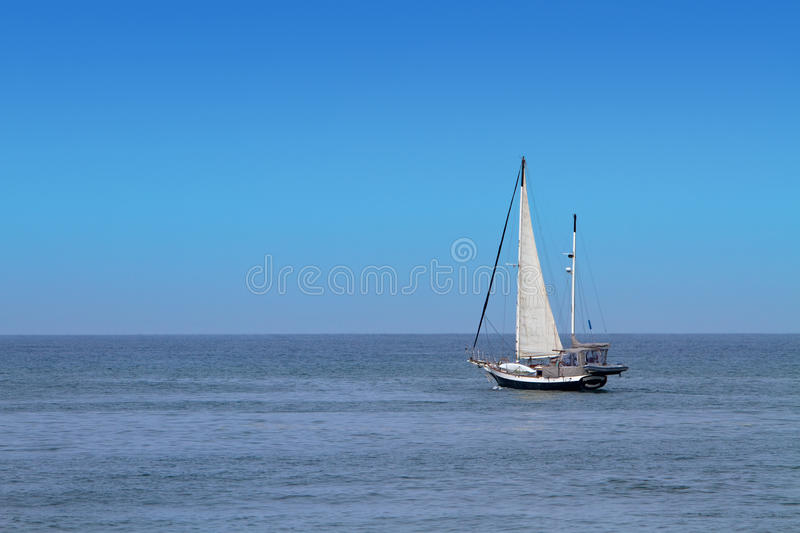 Download Solo Sailboat On Ocean stock image. Image of spinnaker - 13952691