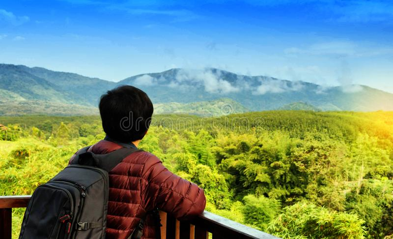 Solo traveller in front of mountain view stock photo