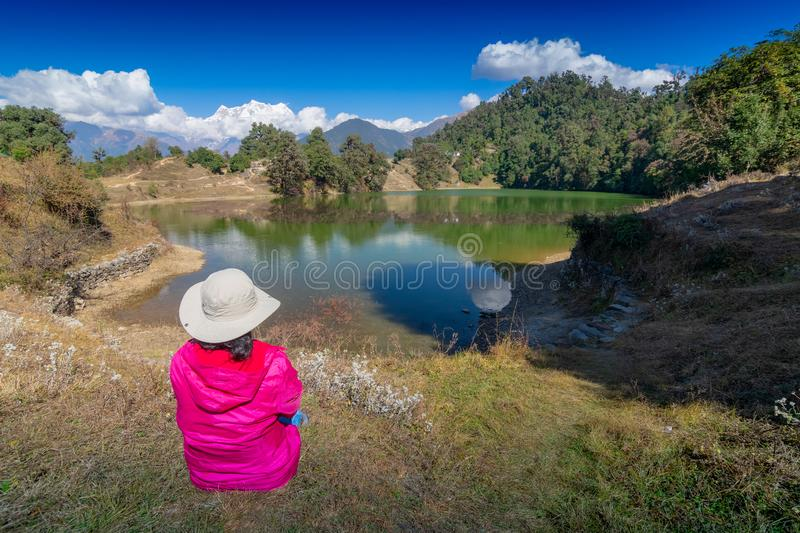 Deoria tal, uttarakhand, India. Solo traveller, single female tourist watching beauty of Deoria Tal , also Devaria or Deoriya tal, high altitude lake in stock photography