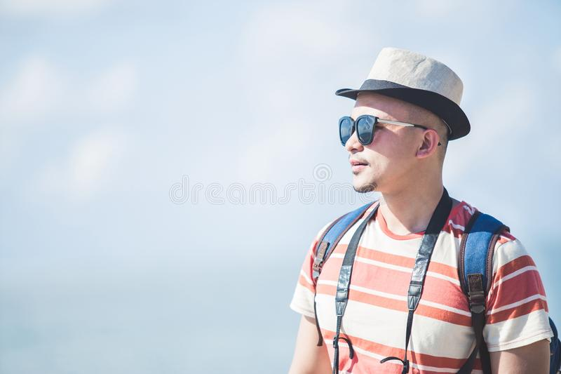 Solo traveller wearing summer hat and sunglasses during vacation. Close up portrait of solo traveller wearing summer hat and sunglasses during vacation on sunny royalty free stock photo