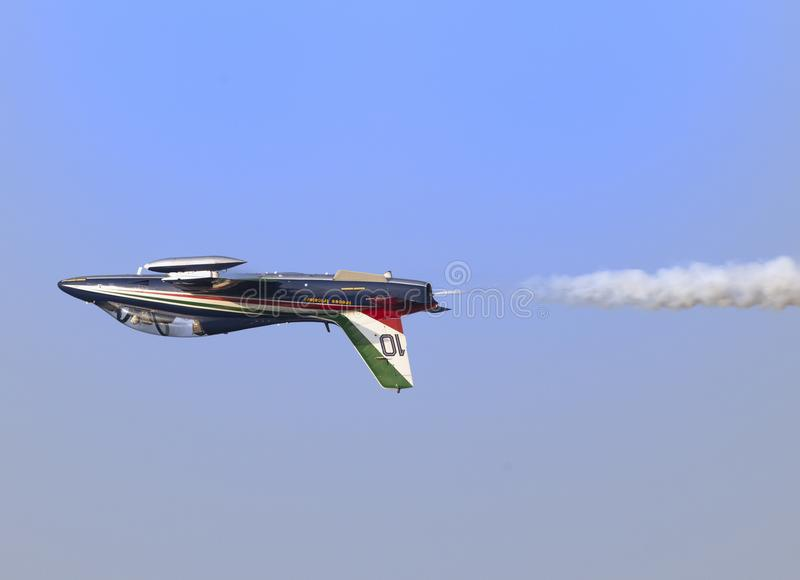 Plane jet upside down flight of soloist at the italian tricolor arrows air show royalty free illustration