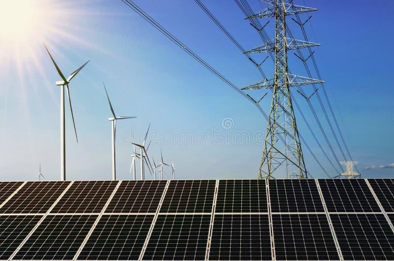 solpanel med vindturebine och hög spänning för elektricitet fotografering för bildbyråer